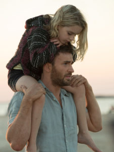 """Mckenna Grace as """"Mary Adler"""" and Chris Evans as """"Frank Adler"""" in the film GIFTED. Photo by Wilson Webb. © 2016 Twentieth Century Fox Film Corporation All Rights Reserved."""