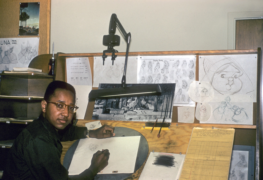 Image Courtesy of ANIMATED LIFE, LLC, Floyd Norman sits at the board as an inbetweener on Sleeping Beauty, 1956